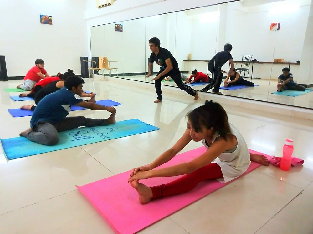 How do we instruct  in our yoga classes at Shahzadpur farm yoga, bandra West, Mumbai