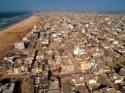Dakar_Roofs_-_Beach_&_Ocean_(5651584098)