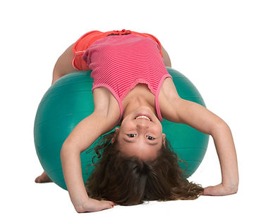 Cute little girl stretching on pilates b