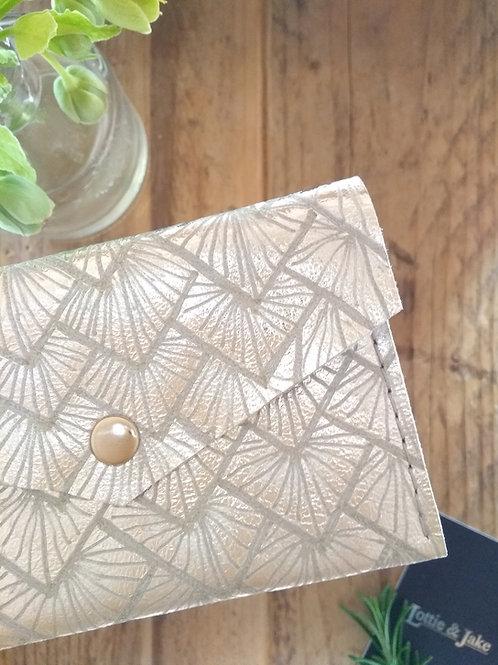 Silver Leather Purse with Sunburst Design.