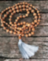 Tulasi wooden rosary beads on the old wo