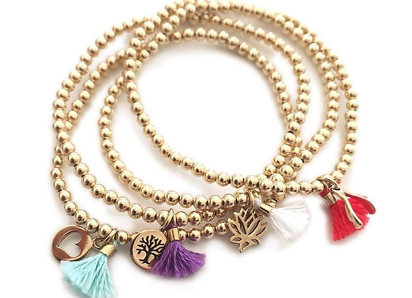 Gold and Tassel Bracelet with Charm
