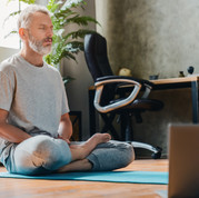 Middle aged sport man doing yoga and fit