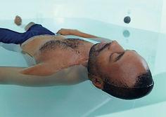 man in float tank