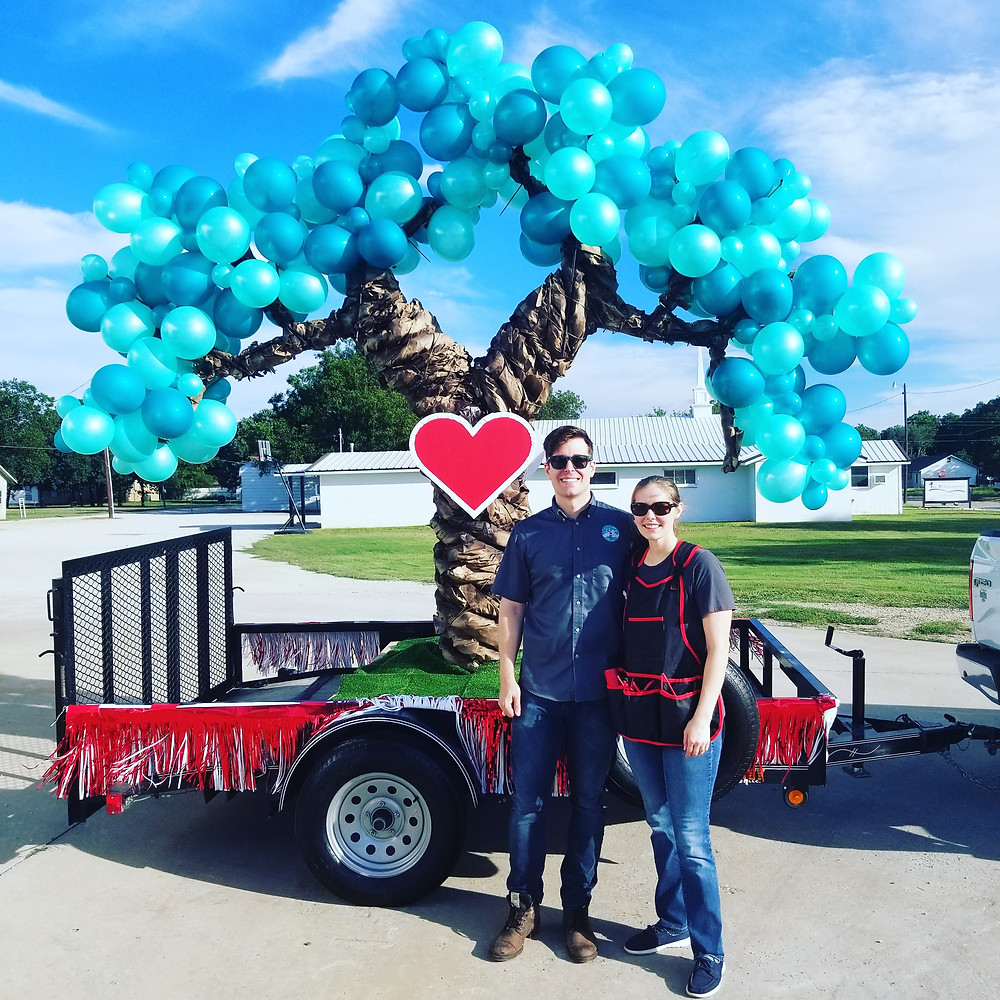 Dr. Benjamin and Heather McNabb owners of Love Oak Pharmacy in Eastland, Texas. Love Oak Parade Float Rip Fest 2018. Old Rip