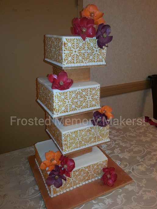 Gold stenciled square wedding cake