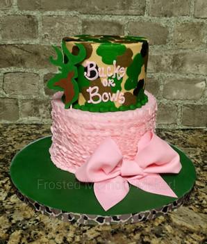 Bucks or Bows gender reveal cake