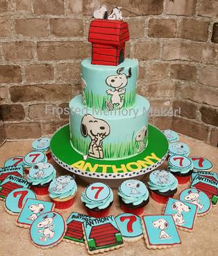 Snoopy themed birthday cake