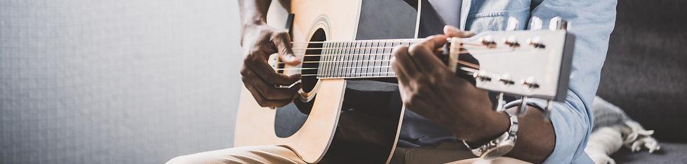 african-american-man-playing-acoustic-gu