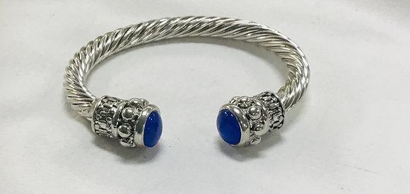 Cuff bracelet with blue stones