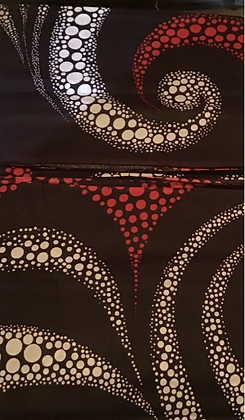 African fabric print, brown, red, white, swirls