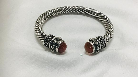 Cuff bracelet with reddish-brown stones