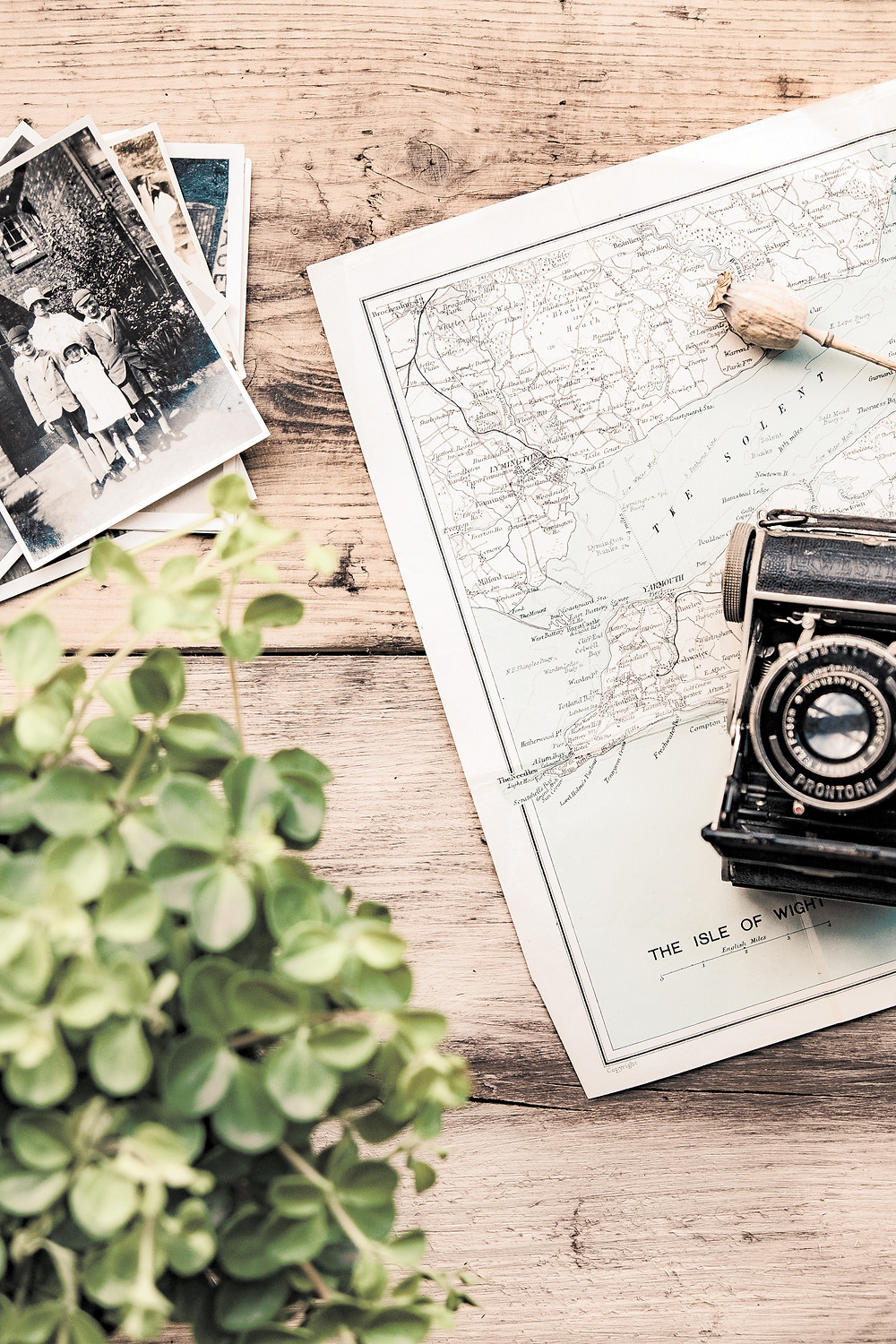 map and photos on table