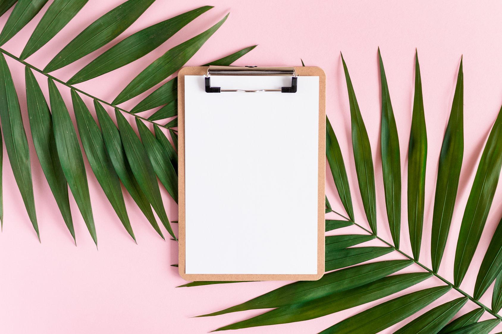 clipboard on pink desk
