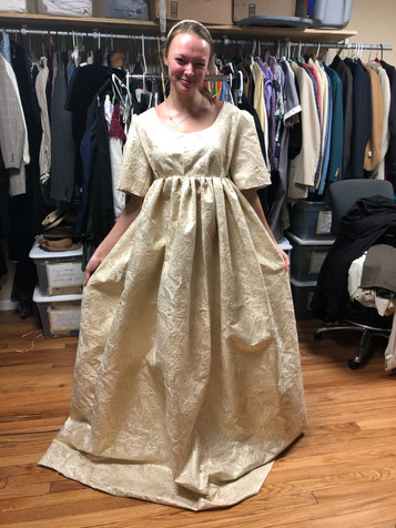 Dress on actress during a fitting