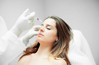 Lady having botox treatment to her upper face at the hands of a professional practitioner
