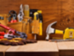 set of working tools on board background