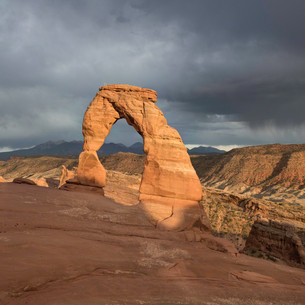 Delicate arch, summer storm at sunset