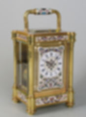 French cariage clock with unusual porcelain enamelled panels