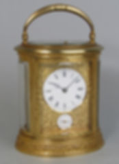 Drocourt engraved French oval carriage clock