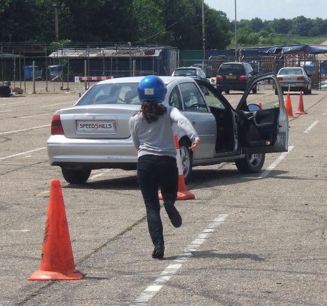 Girl running back to car