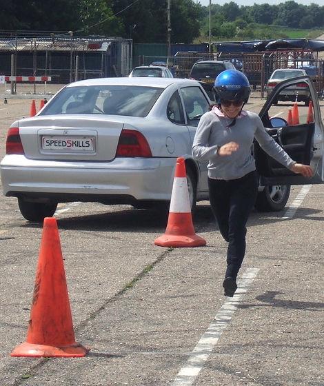 Girl running to cone