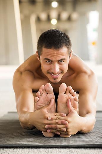 bigstock-Man-practicing-yoga-in-a-urban-