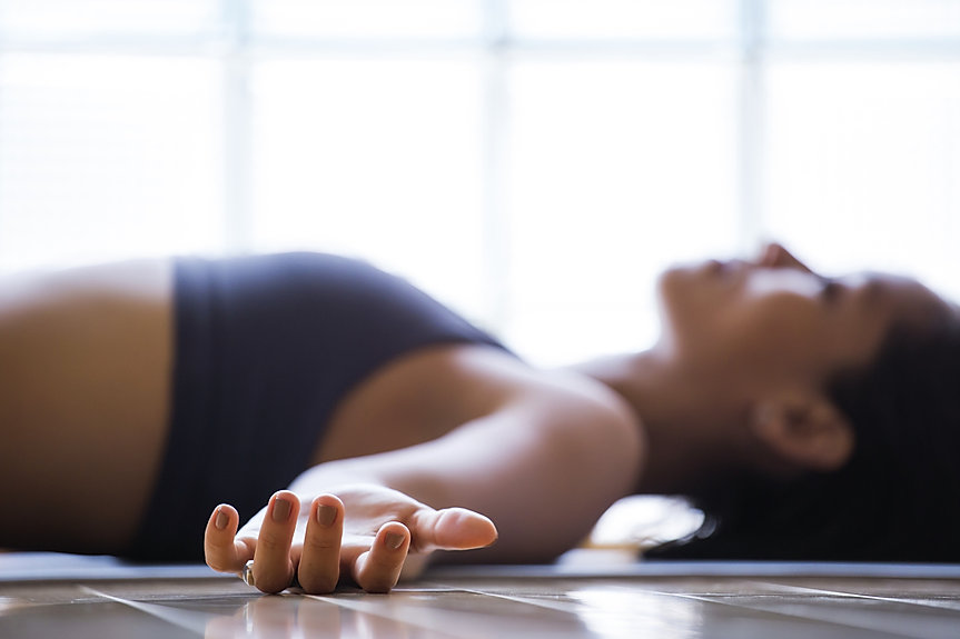 young woman relaxing in yoga