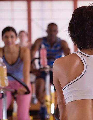 Gym members in a bike class