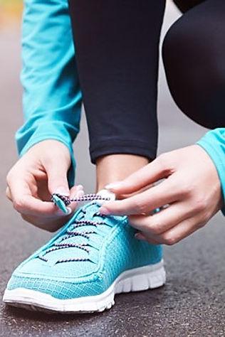 girl tying shoe laces