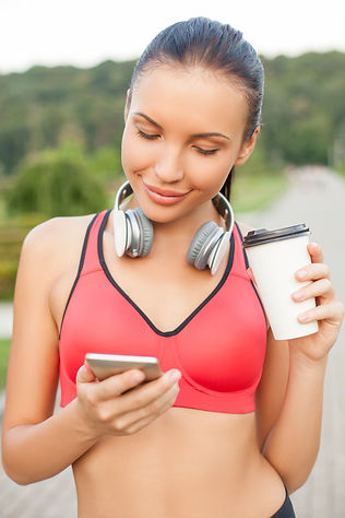 young lady drinking coffee ready to exercise