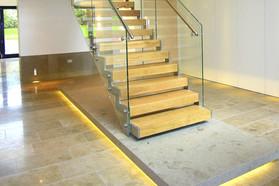Scala vetro, acciaio e legno con base in marmo e LED