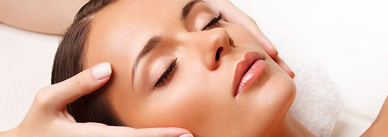 woman having a relaxing luxury facial beauty treatment