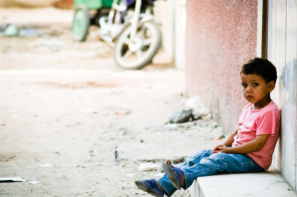 stockvault-sad-little-boy-waiting-outsid