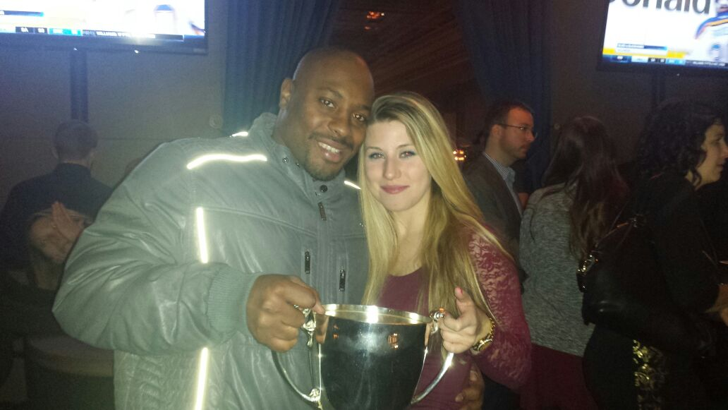 Nik Lewis celebrates the Grey Cup