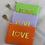 "Thumbnail: Musselin Kosmetiktasche ""Neon Love"" Lila"