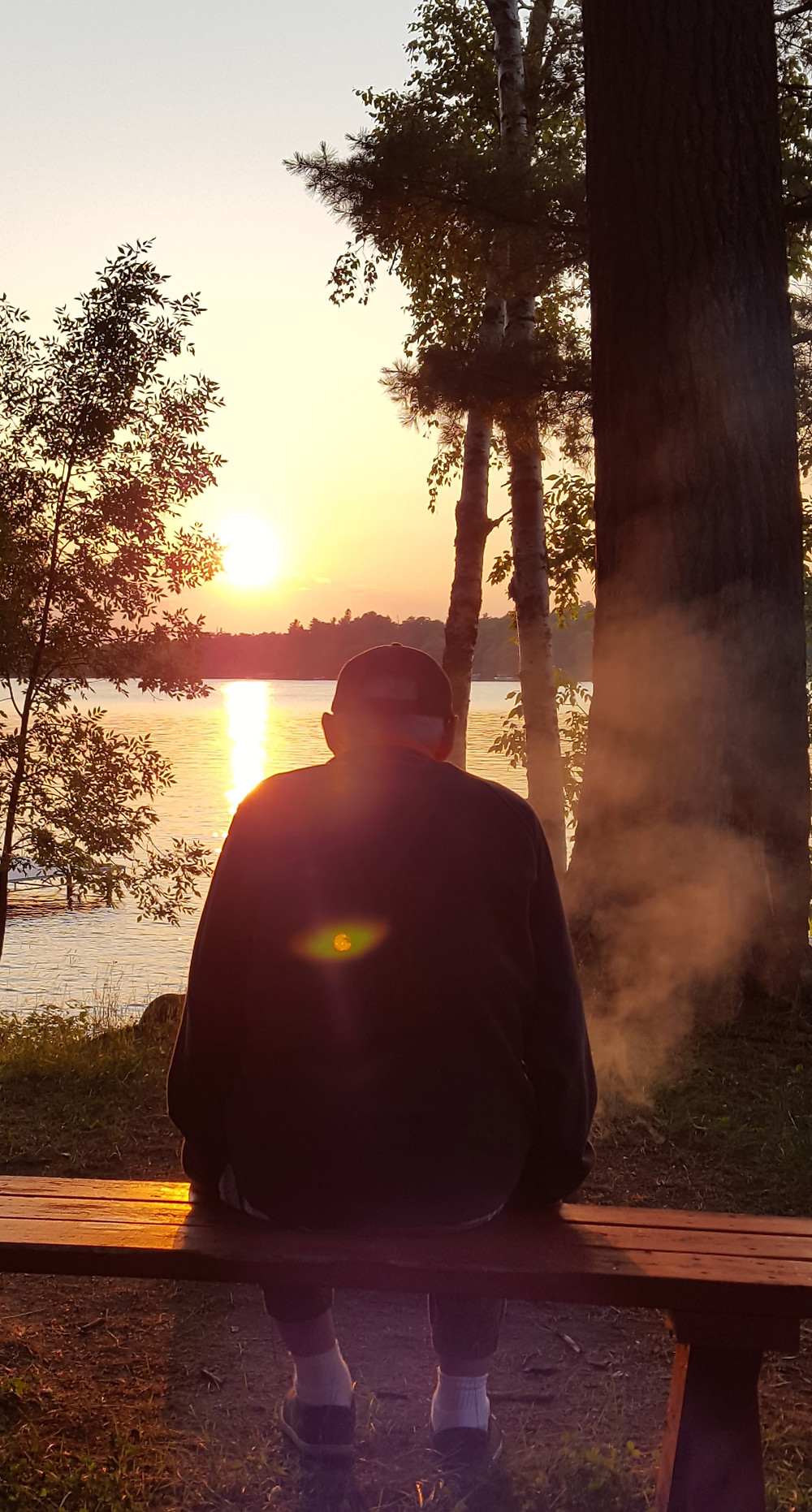 Grampa Bill enjoys a quiet sunset at his cabin.