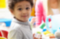 Boy playing with toys in nursery.jpg