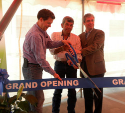 Tom cutting ribbon .jpg