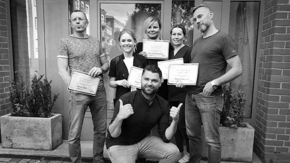 Scalp Micropigmentation Training Group Photo in Poland with Piotr Fliger