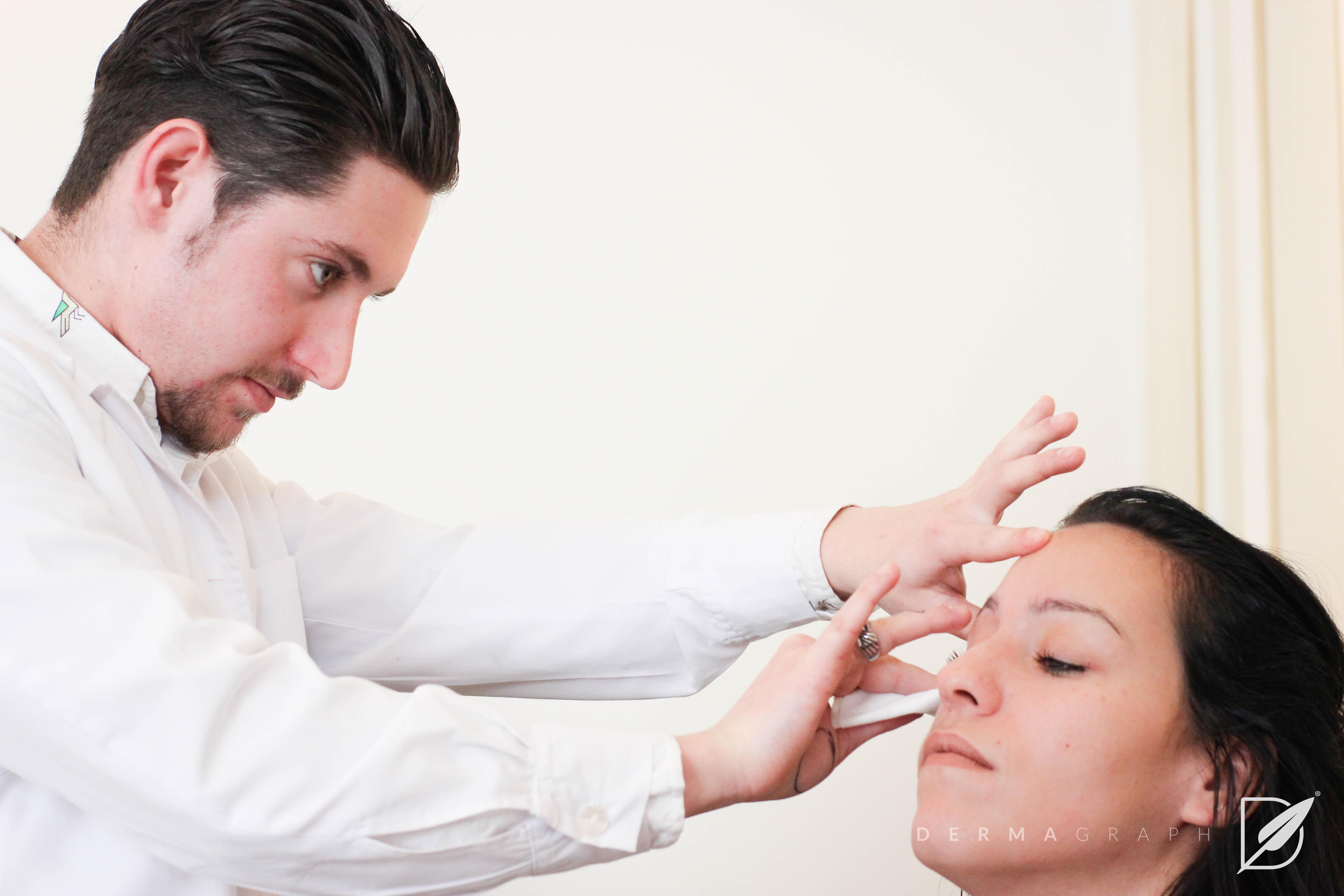 Male applying eyebrow tattoo