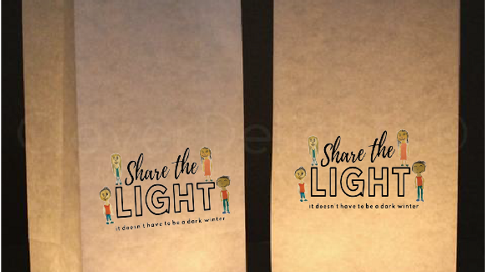 two luminary bags with share the light logo on front