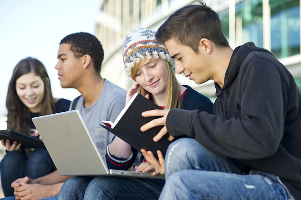 online-students-bible-laptop-outdoors.jp