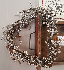 Heart shaped wreath with stars and berries