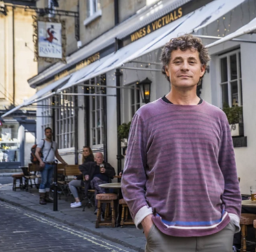 Author Rod Humphris standing outside his pub, The Raven of Bath.