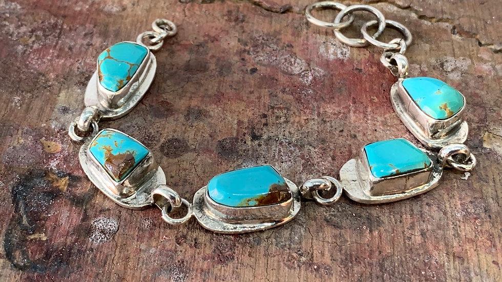 Jude Candelaria Sterling silver Tufa cast link braclet w/kingman Turquoise