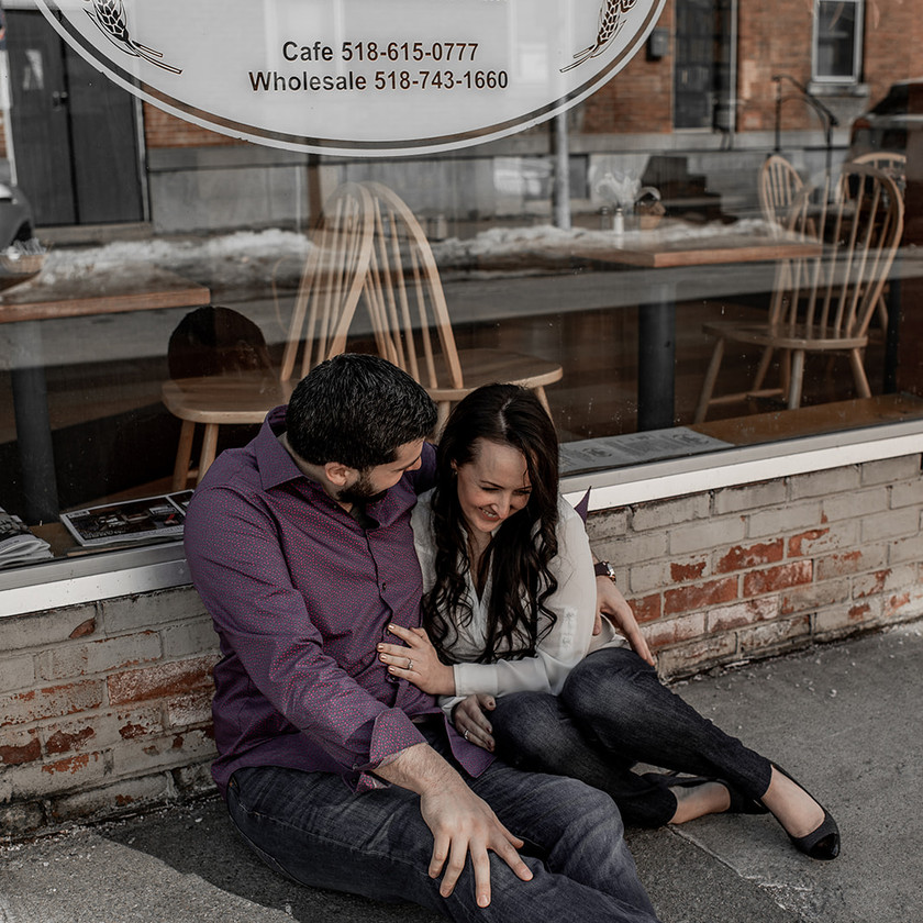Laughing and snuggling engagement photo in Glens Falls NY