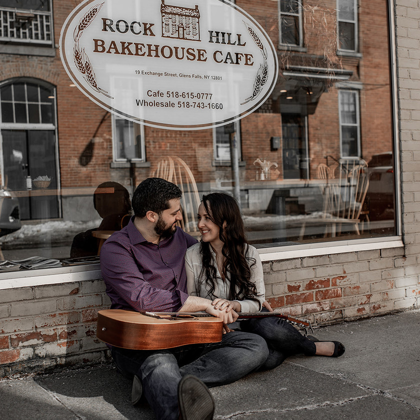 Engagement photos with a guitar at a cute cafe in Glens Falls NY