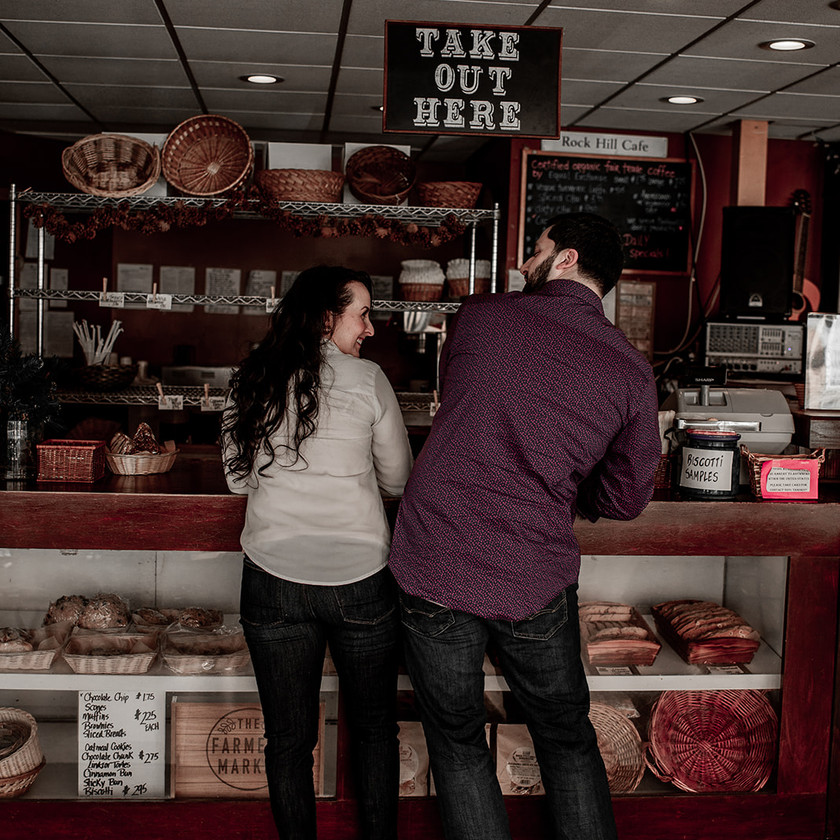 Hip bump couples photo in a cafe in Glens Falls NY
