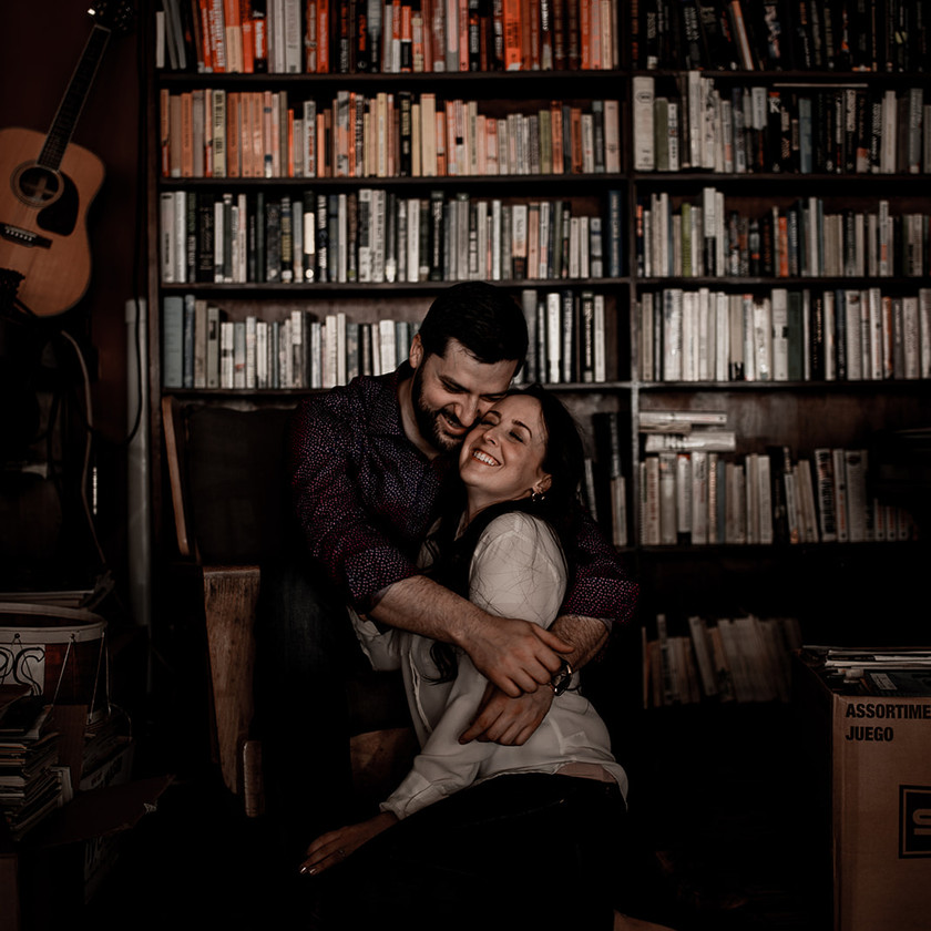 Intimate engagement photos in bookstore in Glens Falls